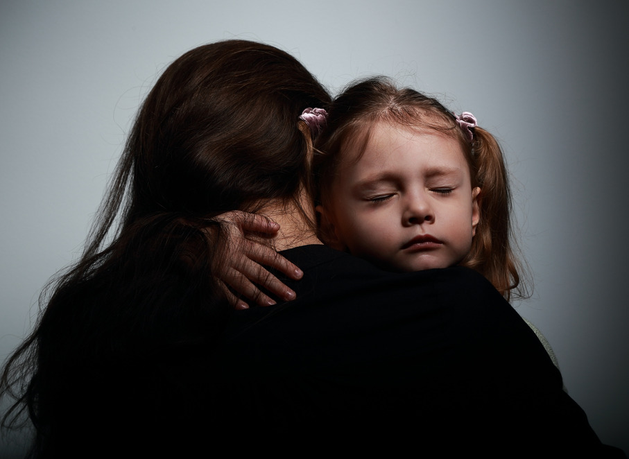 Sad crying daughter hugging her mother with sad face